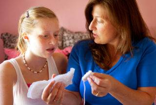 webmd_photo_of_mother_explaining_tampon-320x217.jpg