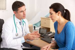 bigstock-American-doctor-talking-to-wom-31746077-300x200.jpg